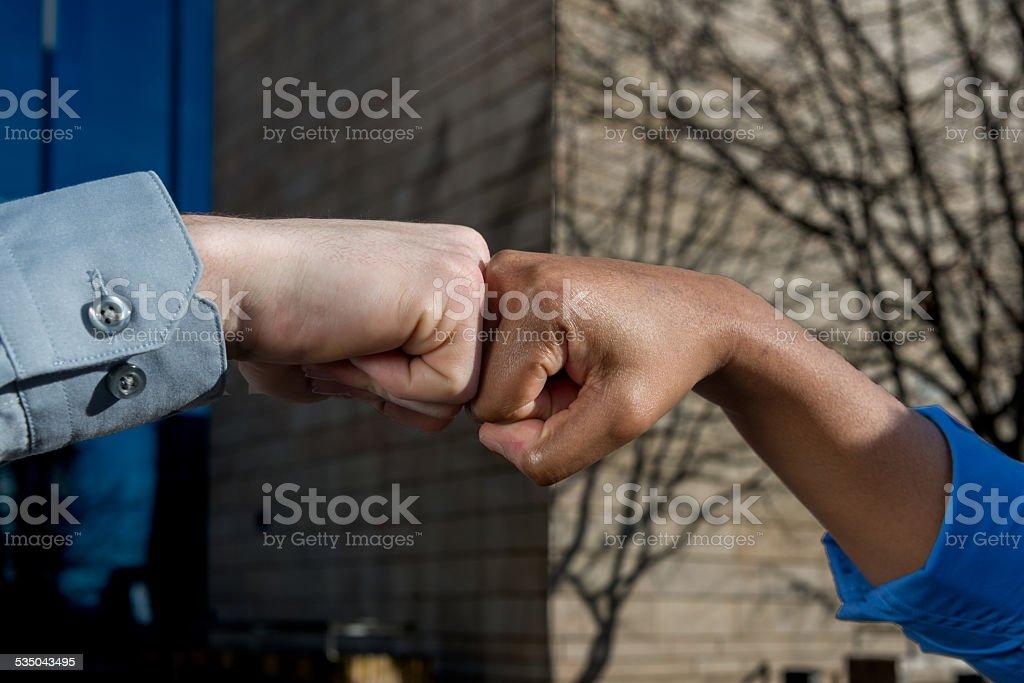 Multiculture fist bump stock photo