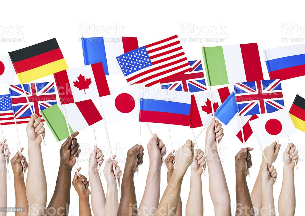 Multiethnic and Diverse Hands Holding National Flags stock photo