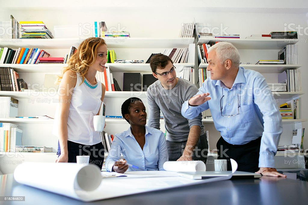 Multi-Ethnic Architects Team Have Meeting. stock photo