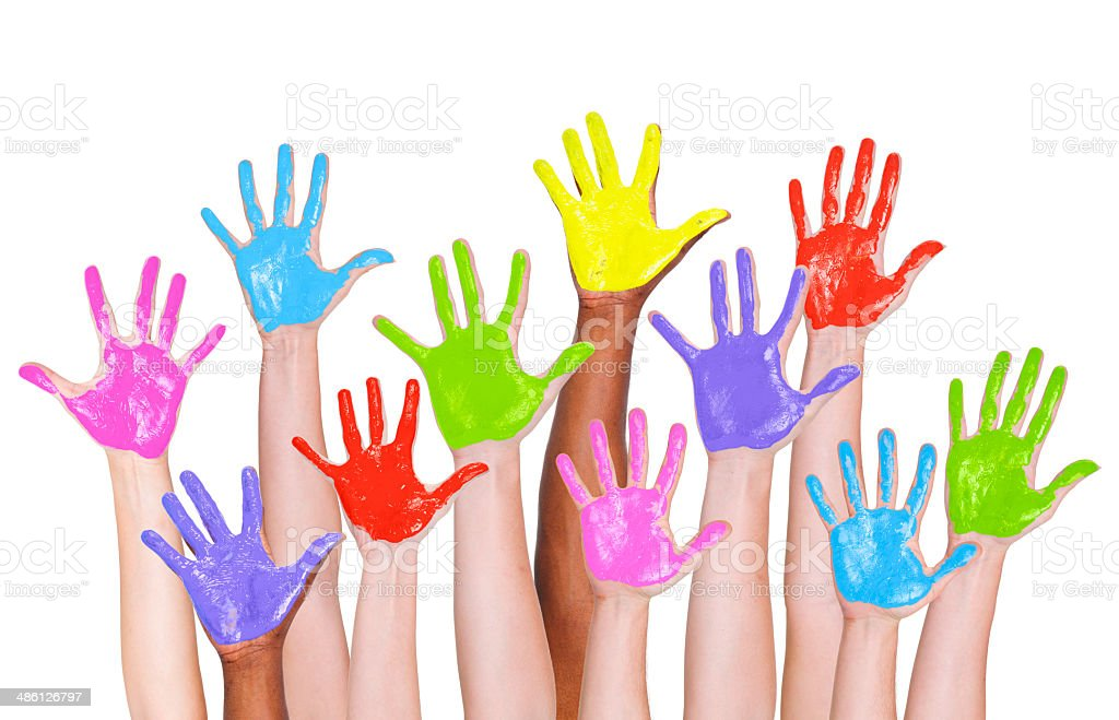 Multi-Ethnic Arms Raised and Colorful Painted Hands stock photo