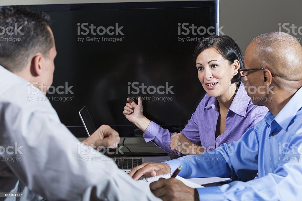 Multi-ethnic business meeting, Hispanic businesswoman talking stock photo