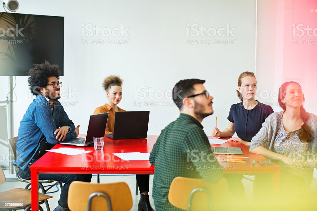 Multi-ethnic business people sitting in conference room stock photo