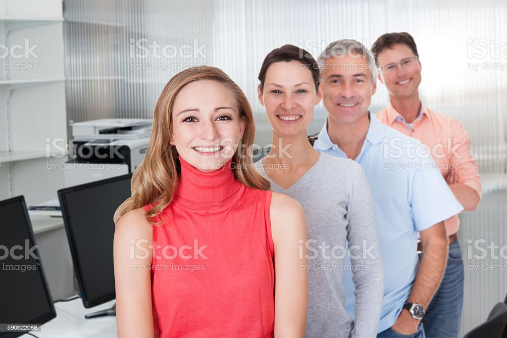 Multiethnic Business People Smiling While Standing In Row stock photo