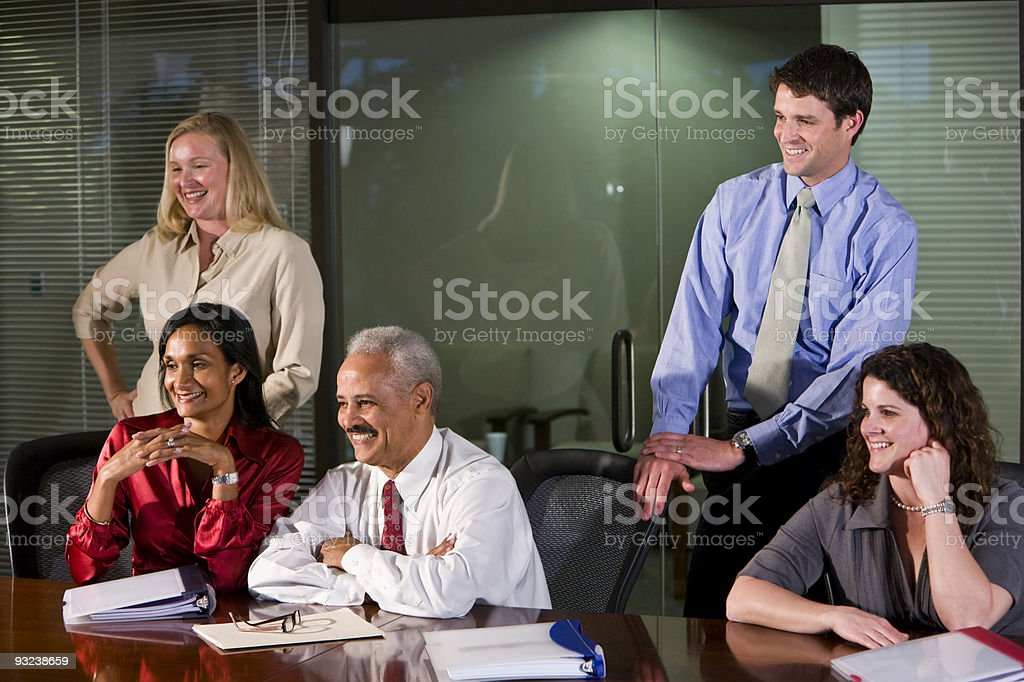 Multi-ethnic business people watching presentation royalty-free stock photo