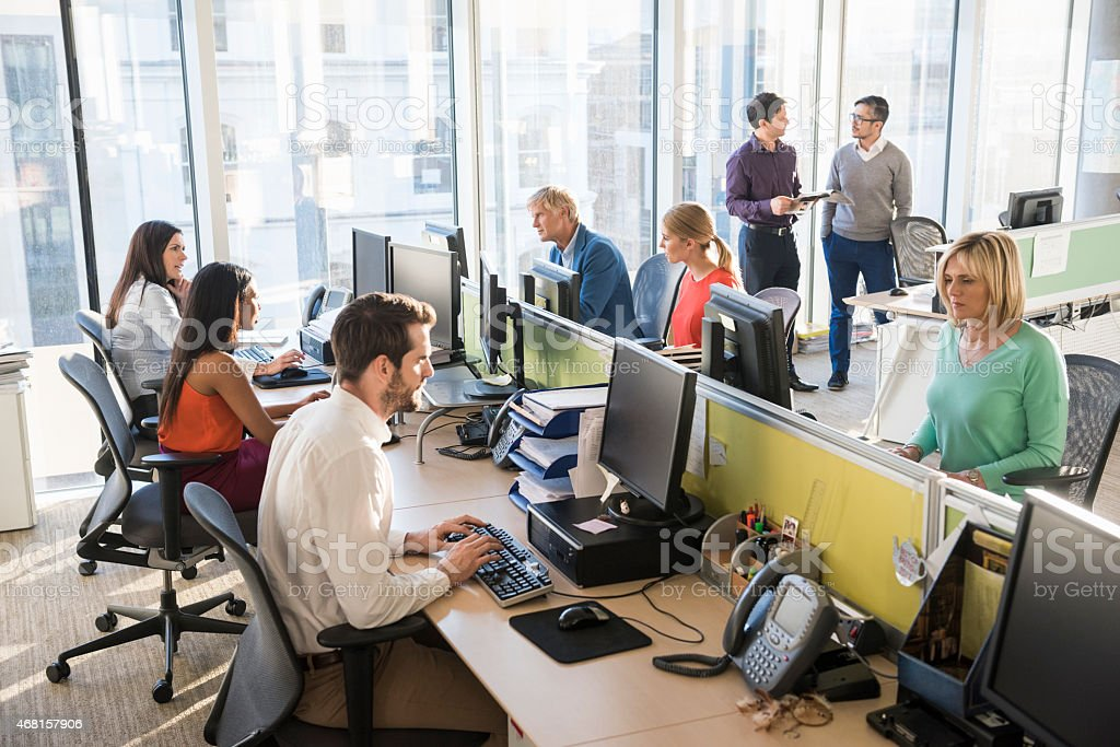 Multi-ethnic business people working together in office stock photo