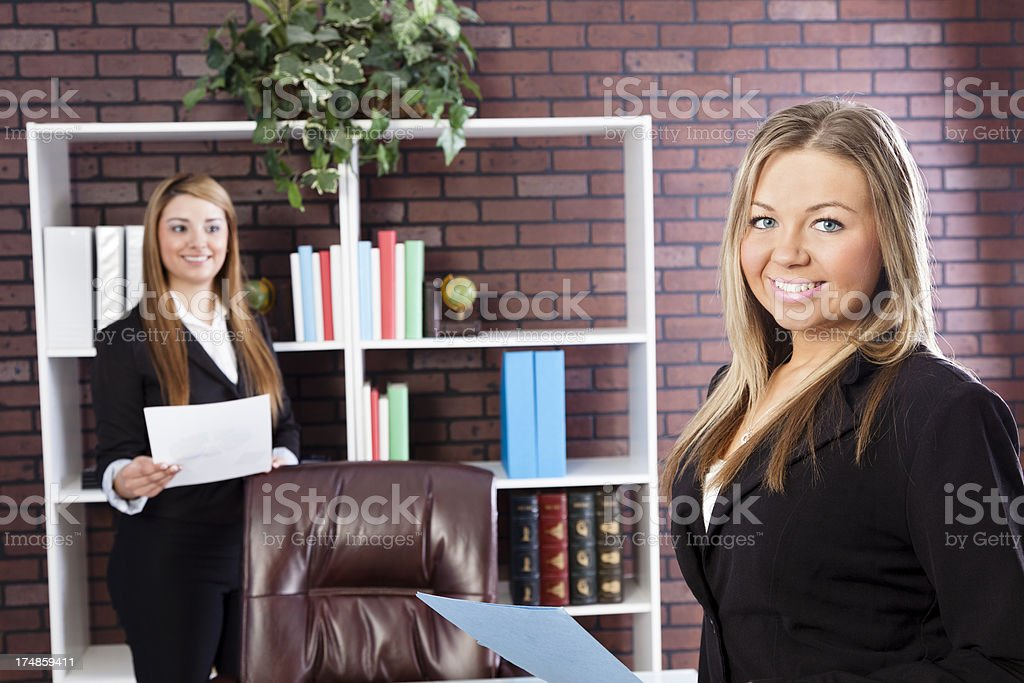 Multi-ethnic business women at desk working together for meeting royalty-free stock photo