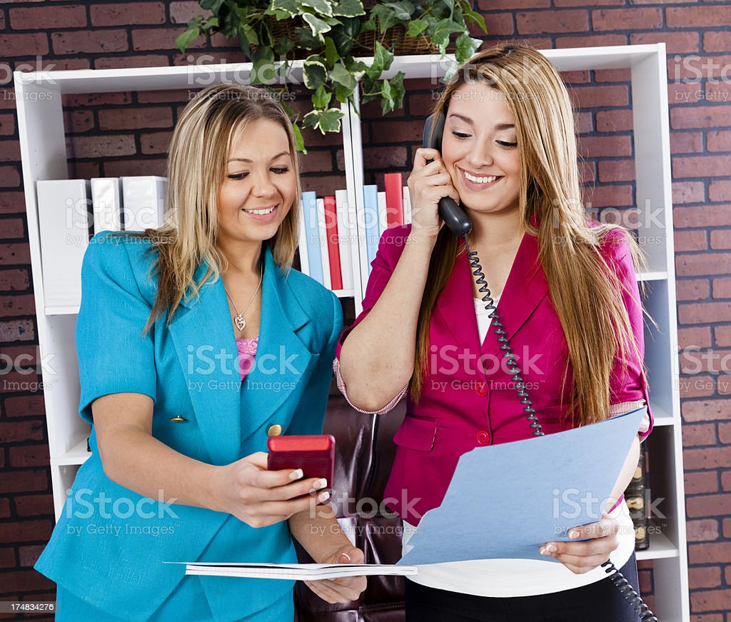 Multi-ethnic business women working together for meeting royalty-free stock photo