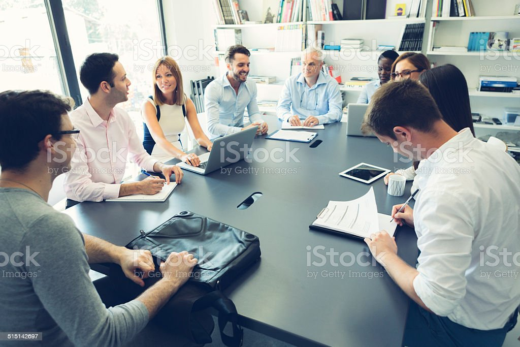 Multi-ethnic Businesspeople Have Meeting. stock photo