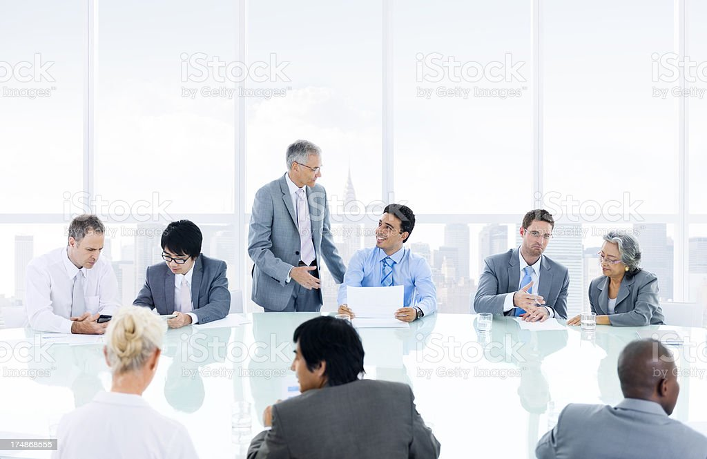 Multiethnic businesspeople in an office meeting stock photo
