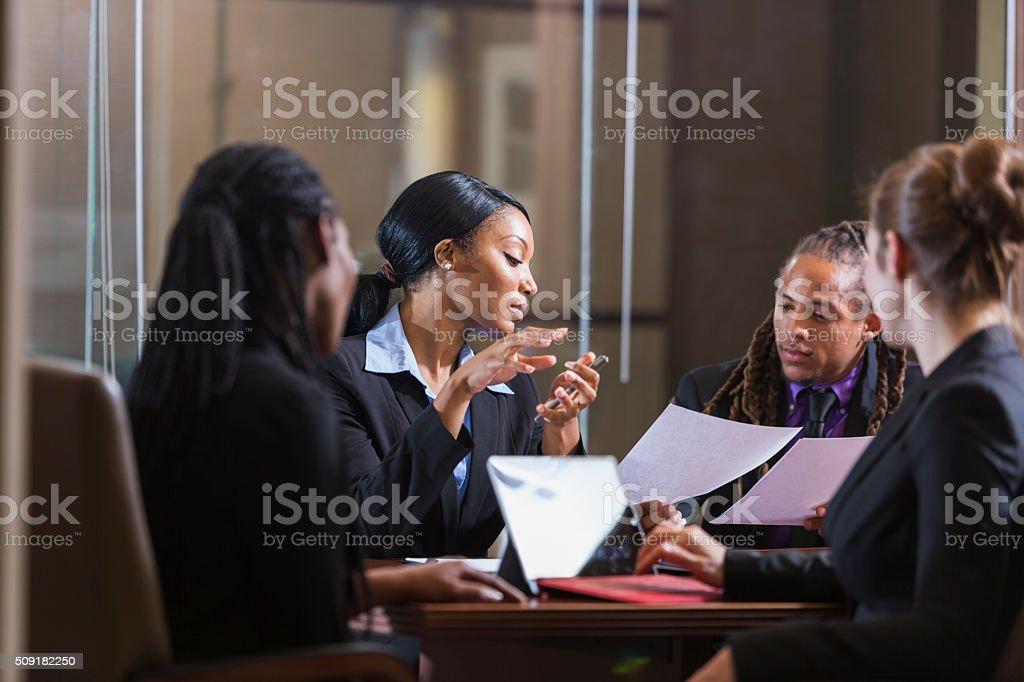 Multi-ethnic businesspeople in boardroom meeting stock photo