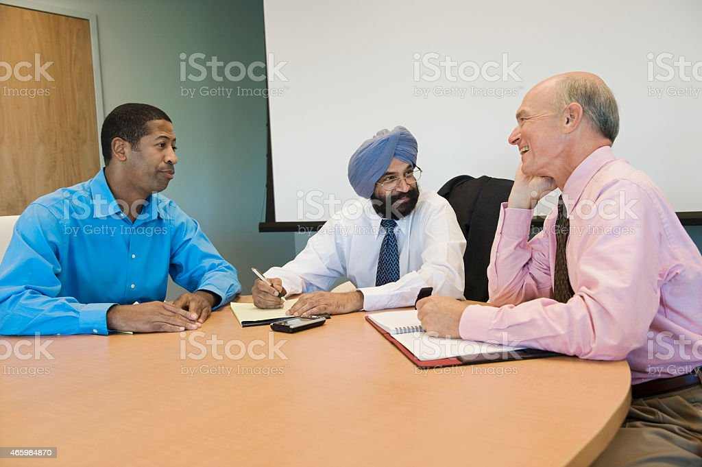 Multiethnic Businesspeople In Meeting stock photo
