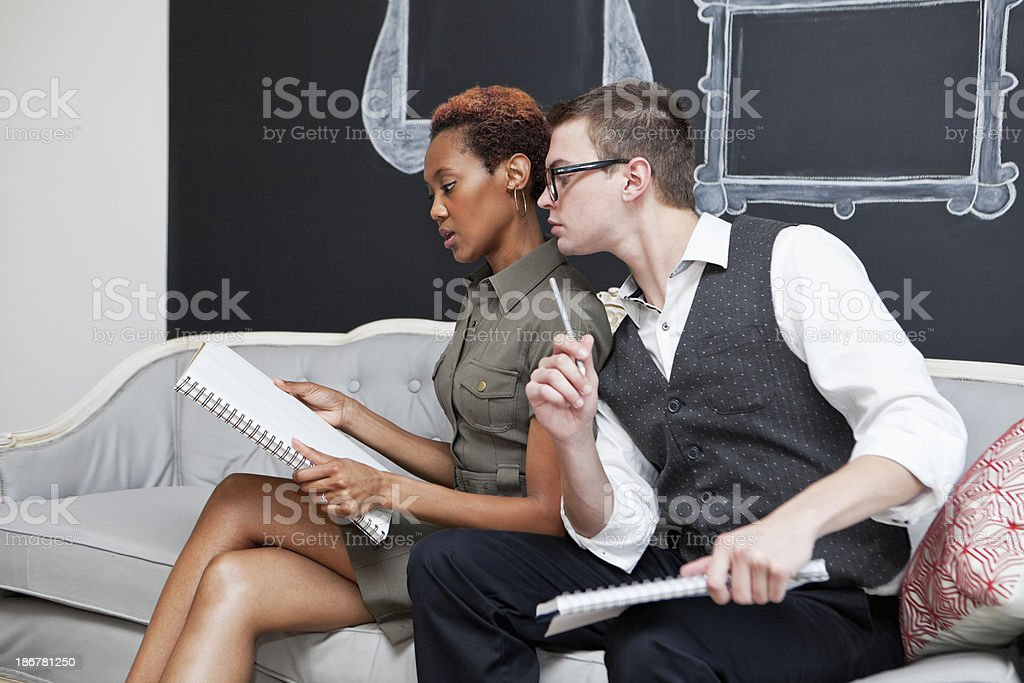 Multi-ethnic businsess people collaborating royalty-free stock photo