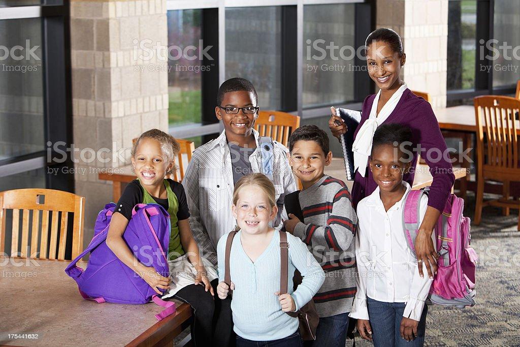 Multi-ethnic children in school with teacher royalty-free stock photo