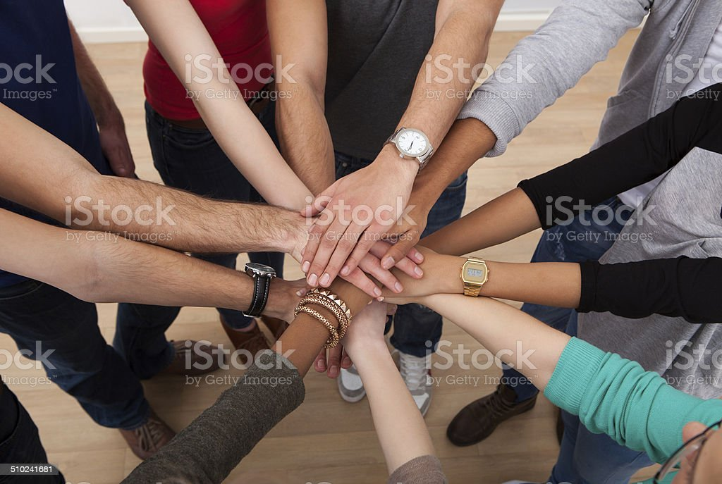 Multiethnic College Students Stacking Hands stock photo