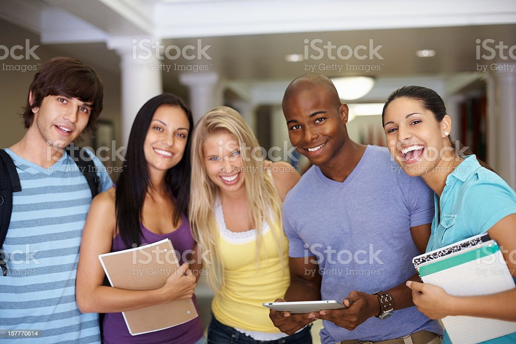 Multi-ethnic college students standing together in a line royalty-free stock photo