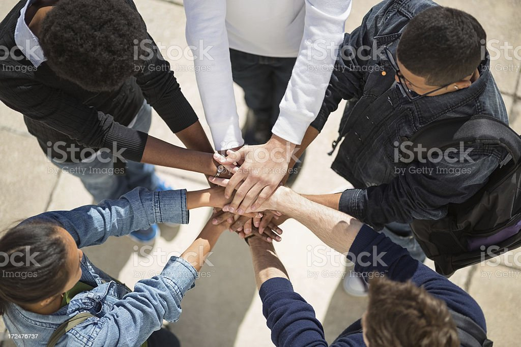 Multi-Ethnic College Students With Hands Together royalty-free stock photo