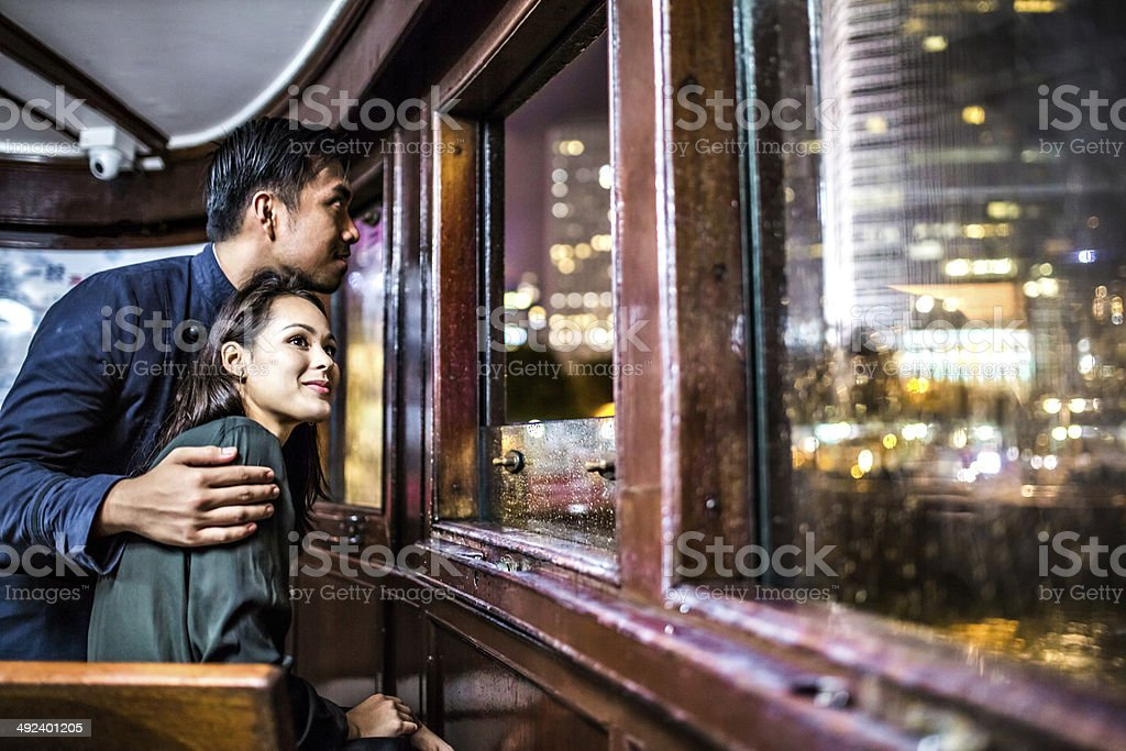 Multi-ethnic couple in Hong Kong traveling ferry stock photo