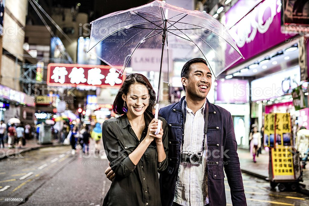 Multi-ethnic couple in Hong Kong walking street stock photo