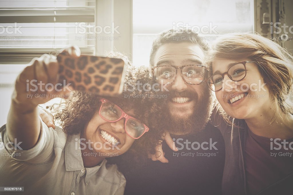 Multiethnic crazy selfie together stock photo