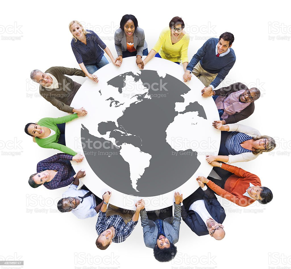 Multiethnic Diverse People in a Circle Holding Hands stock photo