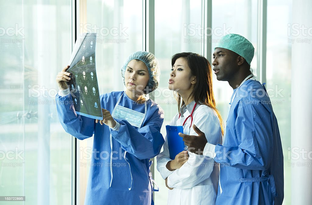 Multi-ethnic doctors consulting royalty-free stock photo