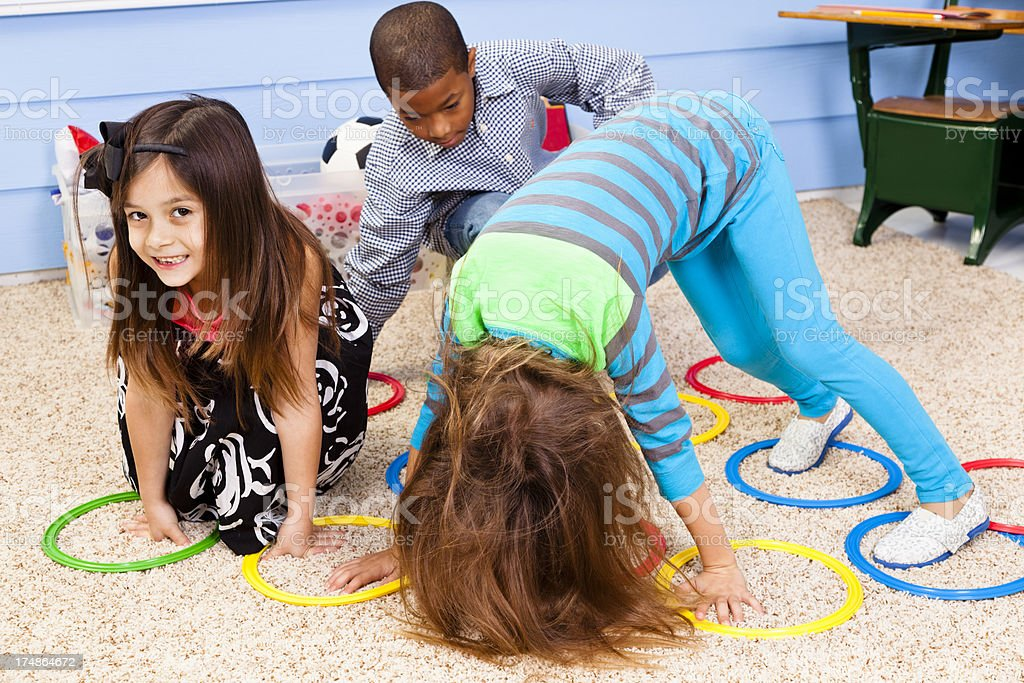 Multi-ethnic Elementary 7-8 year olds playing games in school royalty-free stock photo