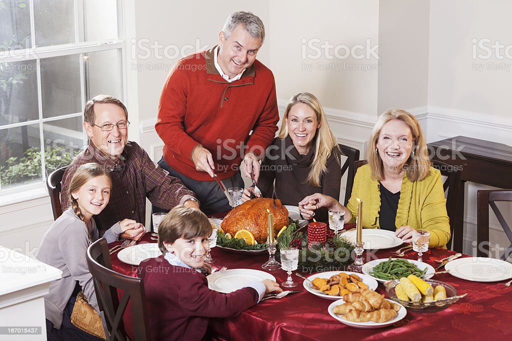 Multi-ethnic family enjoying holiday dinner royalty-free stock photo