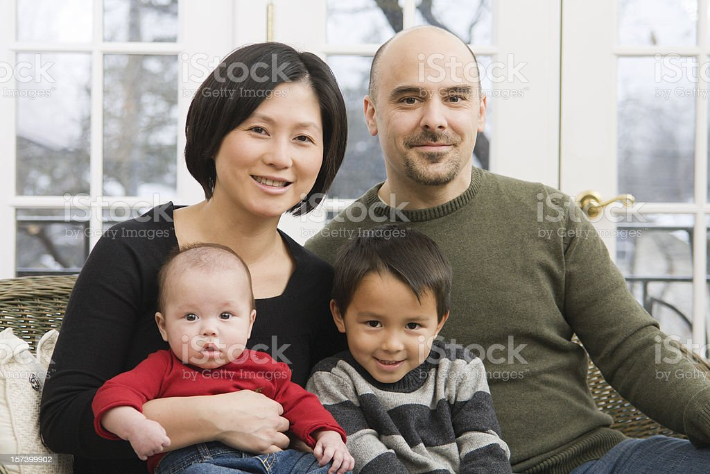 Multi-ethnic Family, Mother, Father, and Two Sons Together at Home royalty-free stock photo