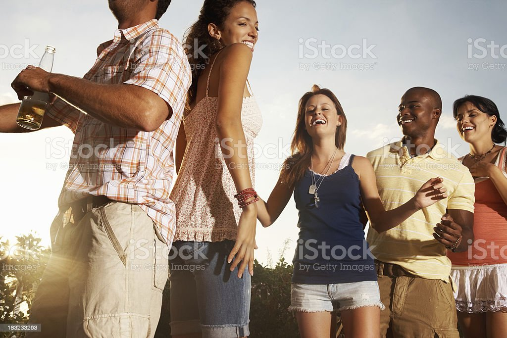 Multi-ethnic friends dancing together on a spring break vacation royalty-free stock photo