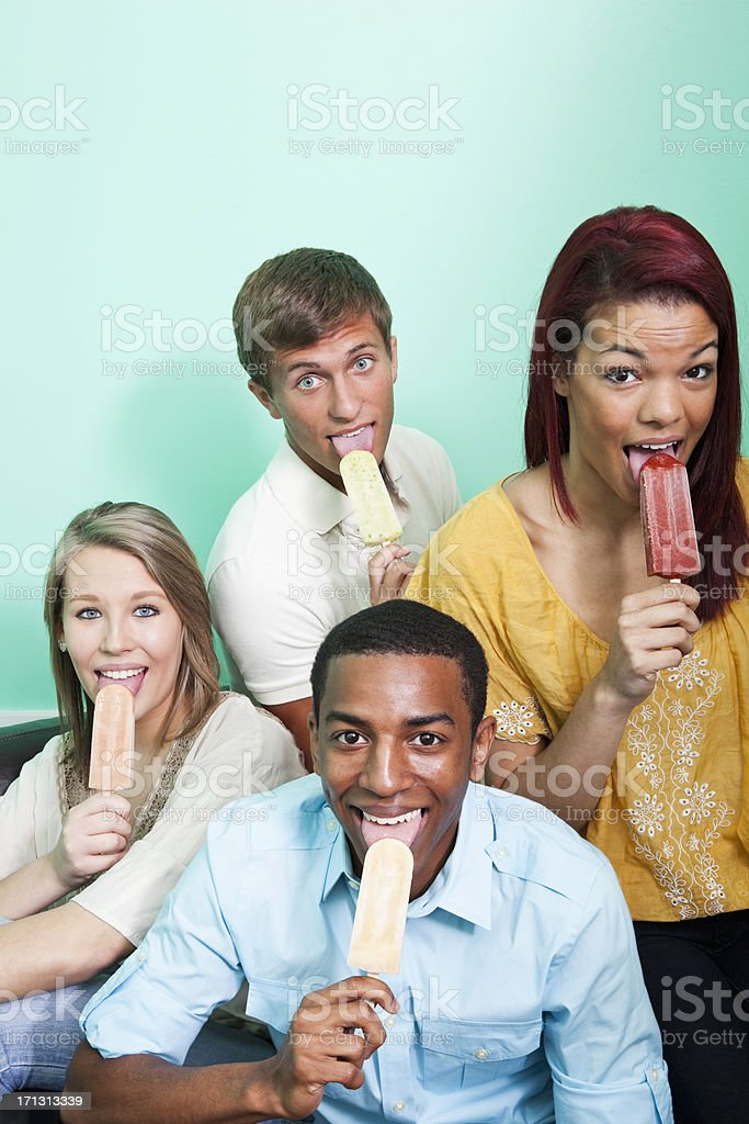 Multi-ethnic friends eating popsicles royalty-free stock photo