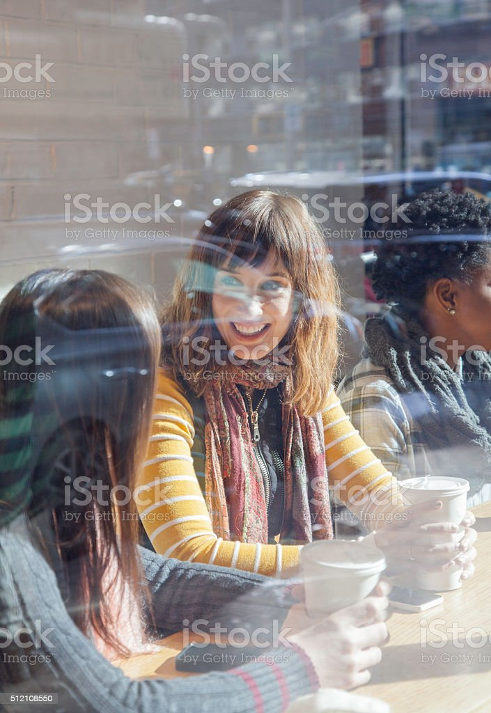Multi-Ethnic Friends having coffee together stock photo