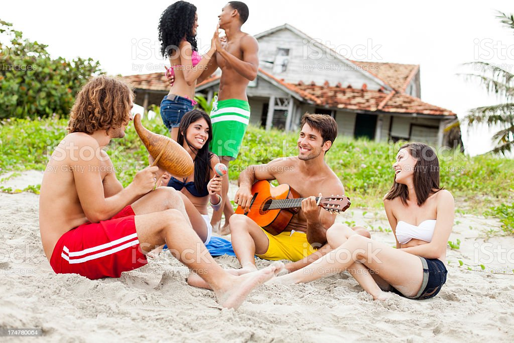 Multi-ethnic friends having fun on the beach royalty-free stock photo