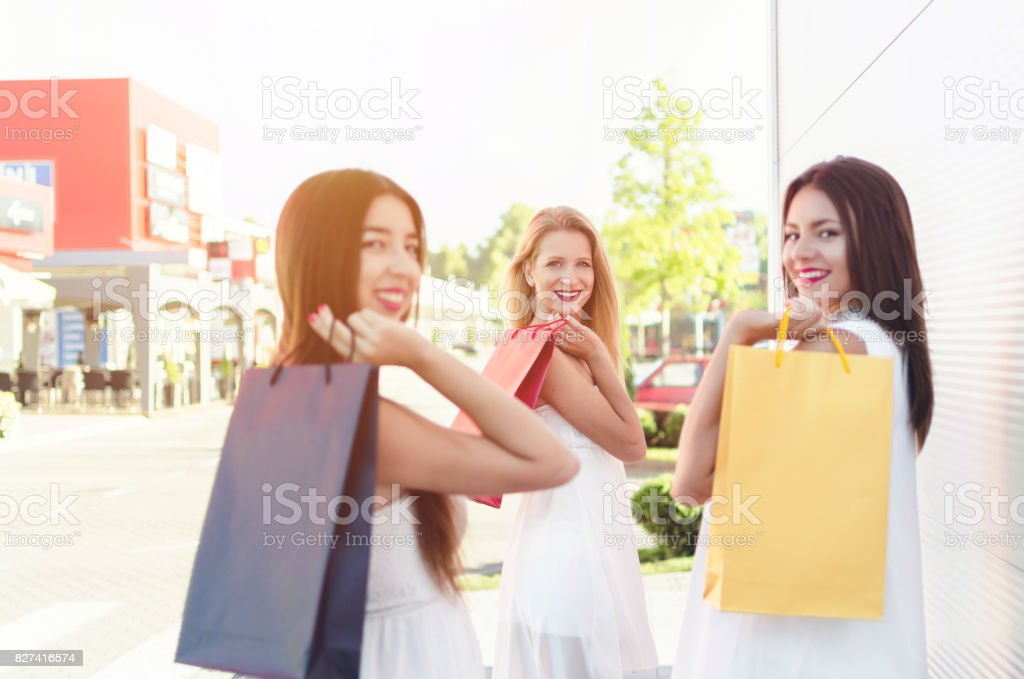 multiethnic friends in shopping stock photo