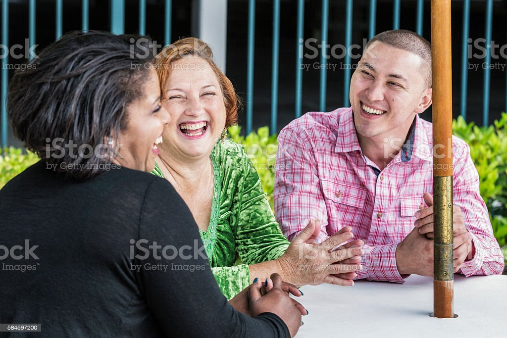 Multi-Ethnic Friends Laughing Sharing Outdoors Team Meeting Joke stock photo