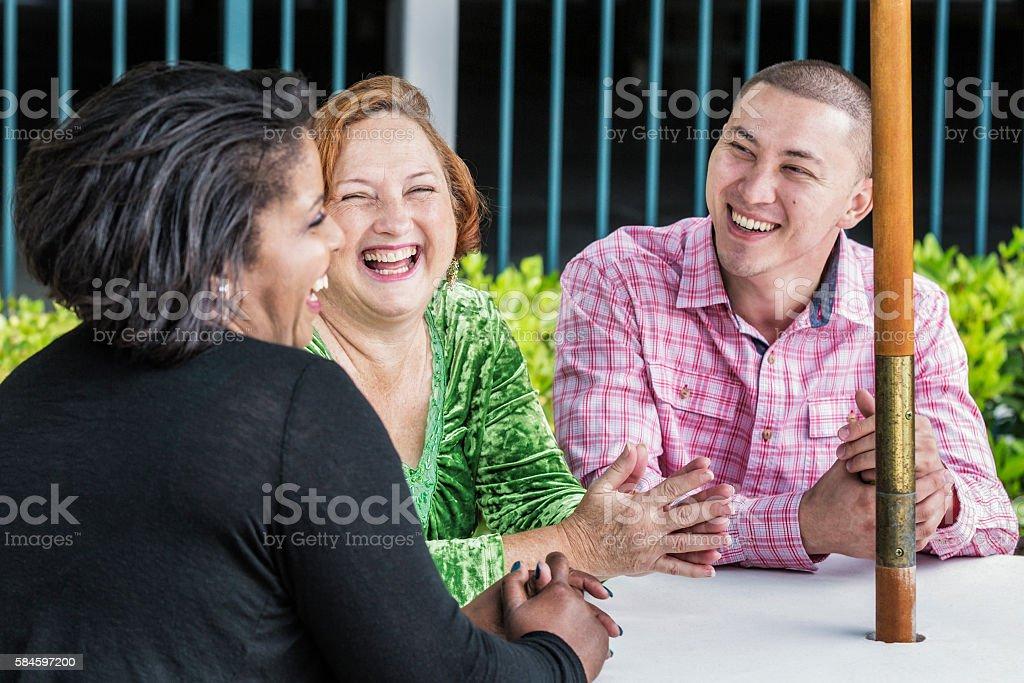Multi-Ethnic Friends Laughing Sharing Outdoors Team Meeting Joke stock photo