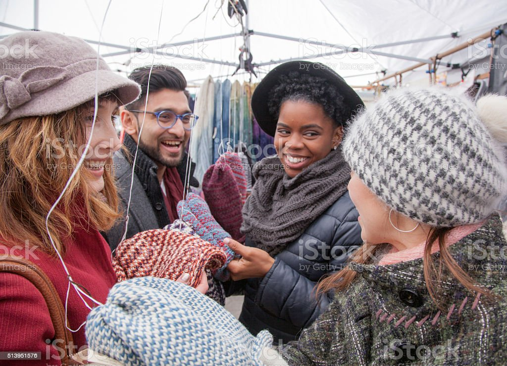 Multi-Ethnic Friends shopping together in city market stock photo