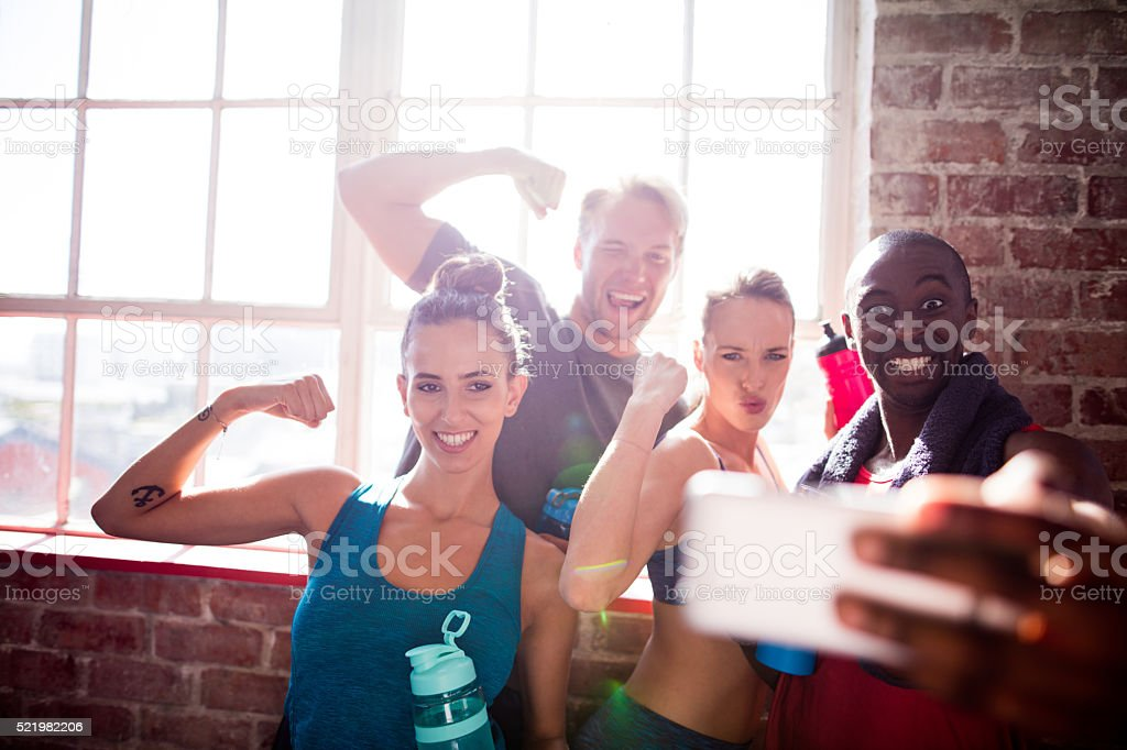 Multi-ethnic friends taking selfie at the gym stock photo