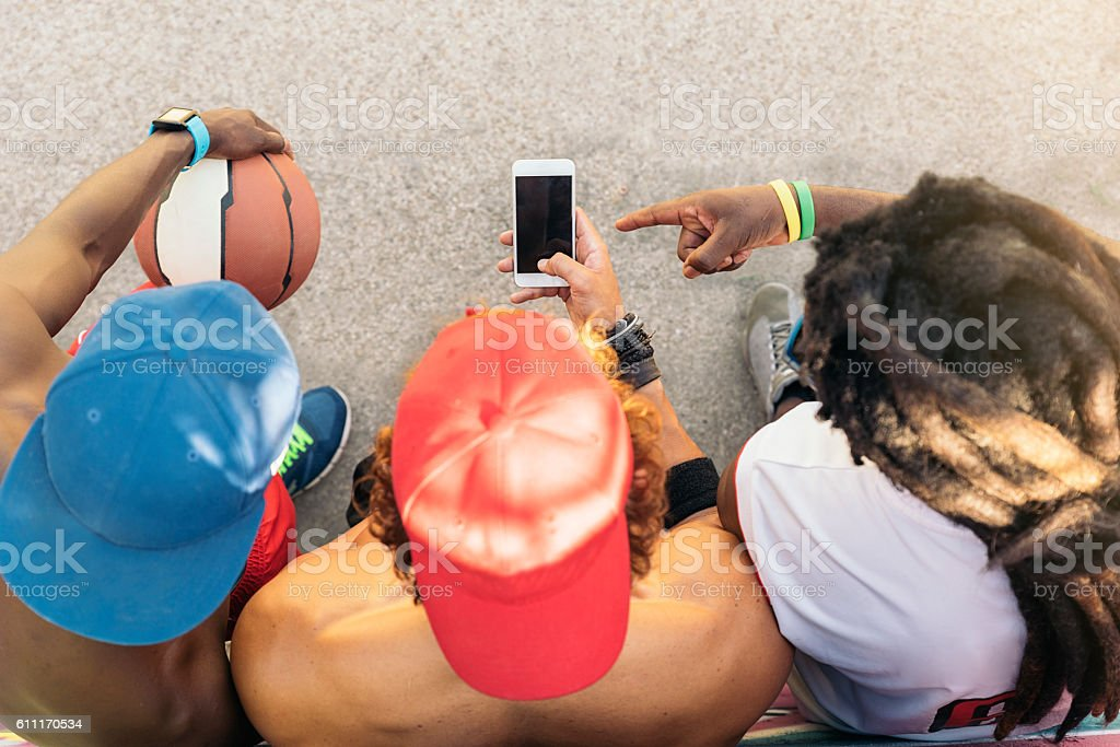 Multiethnic Friends Using Mobile. stock photo