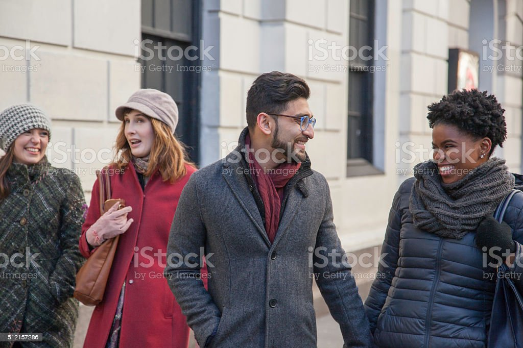 Multi-Ethnic Friends walking together in the city stock photo