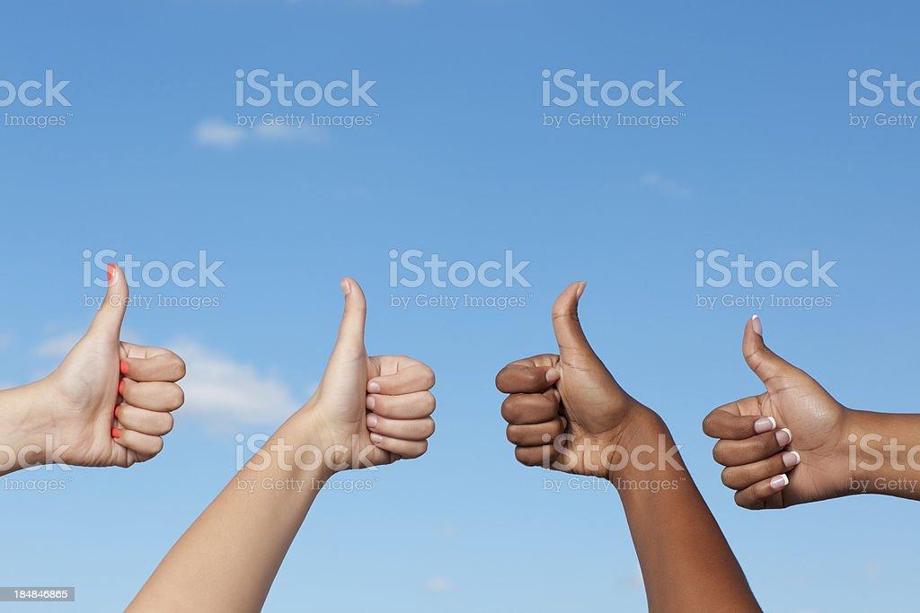 Multi-Ethnic Group giving tumb up. stock photo