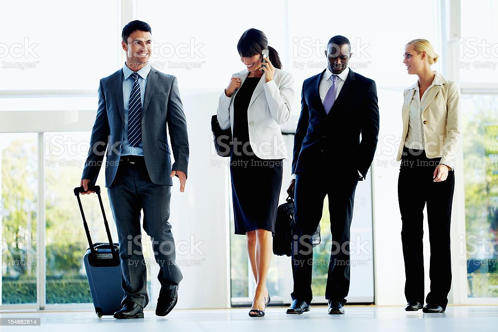 Multiethnic group of business people at an airport royalty-free stock photo