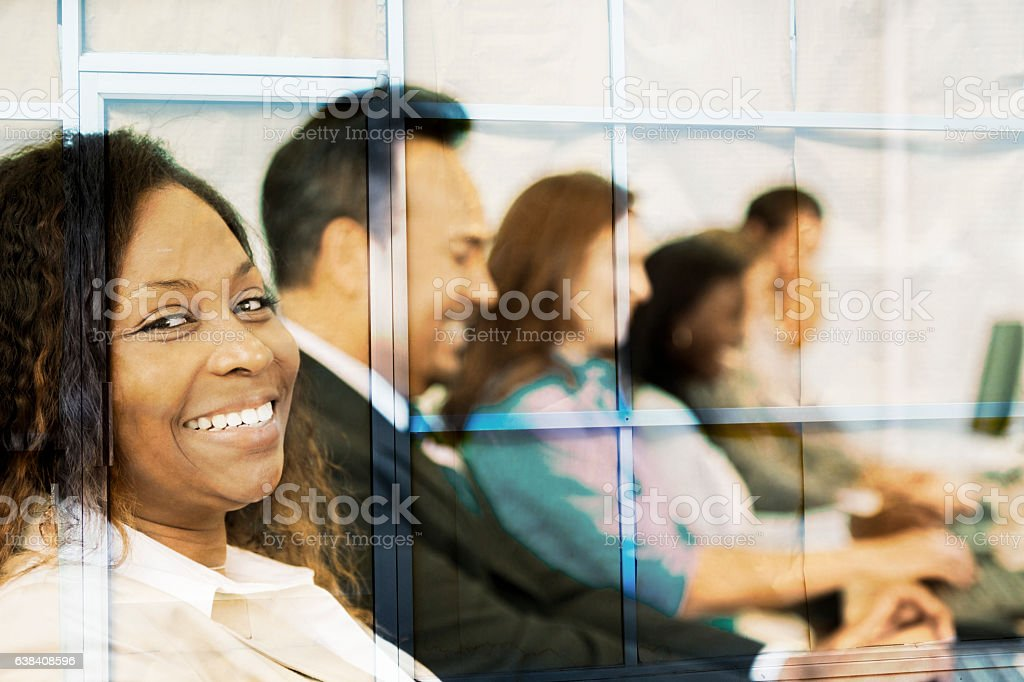 Multi-ethnic group of business people composite with office building. stock photo
