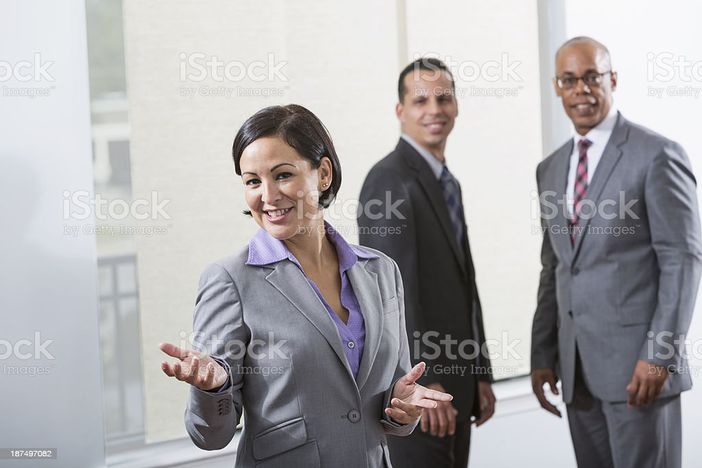 Multi-ethnic group of business people, Hispanic businesswoman in foreground royalty-free stock photo