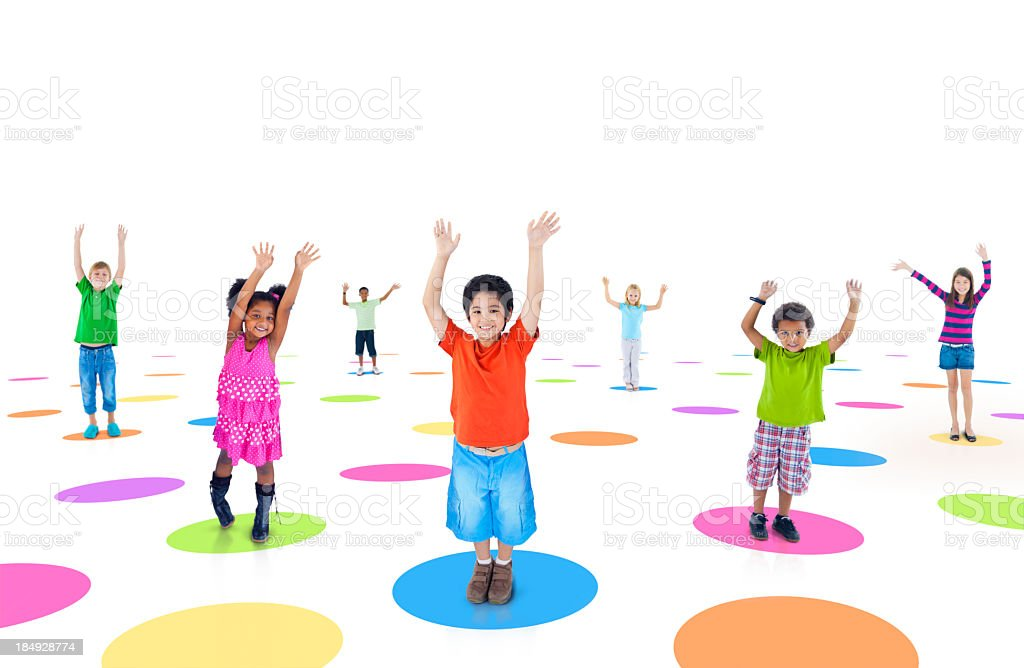 Multi-ethnic group of children cheering royalty-free stock photo