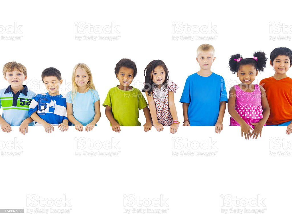 Multi-ethnic group of children holding board stock photo