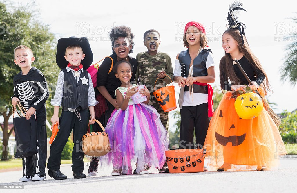 Multi-ethnic group of children in halloween costumes stock photo