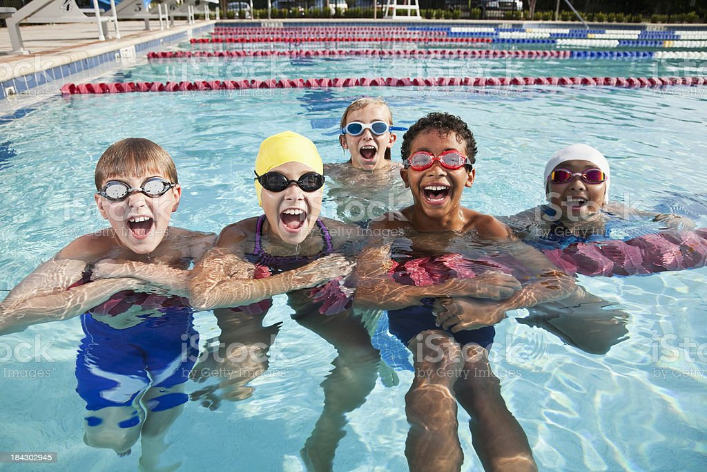Multi-ethnic group of children shouting in swimming pool stock photo