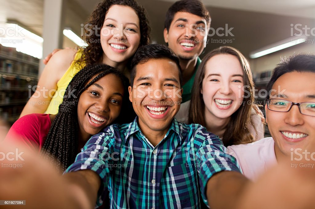 Multi-ethnic group of college students taking a selfie stock photo
