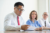 A multi-ethnic group of doctors and nurses are going