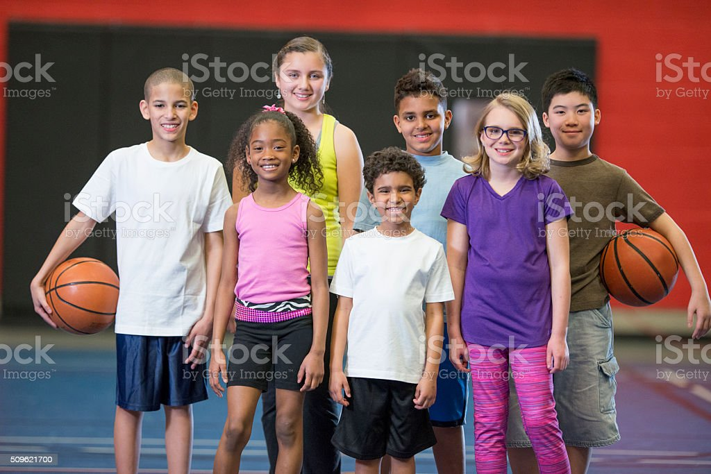 A multi-ethnic group of elementary age children are stock photo